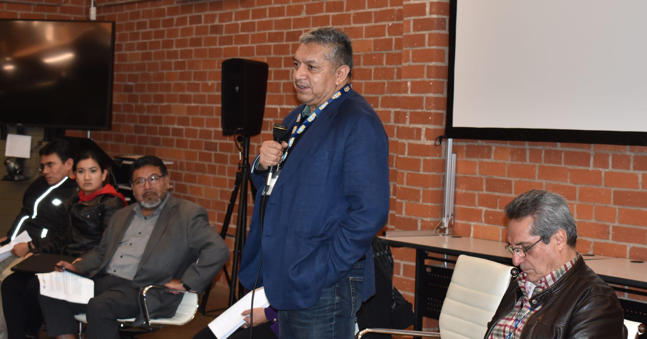 Jose Humberto Montes de Oca speaking into a microphone