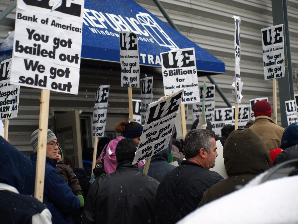 """UE members picketing Republic Windows and Doors with signs reading """"You got bailed out, we got sold out"""""""
